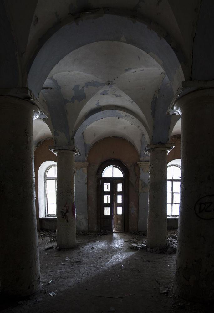 abandoned columned hall by kartavitsky