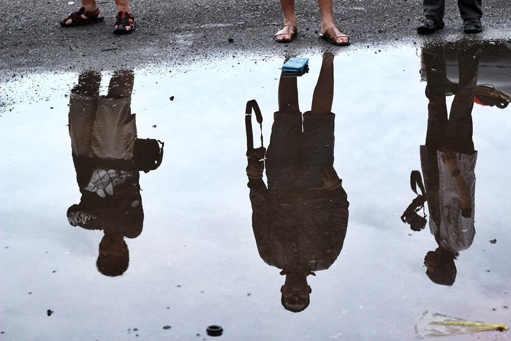 Three photographers in reflection.... by aiyakenzei
