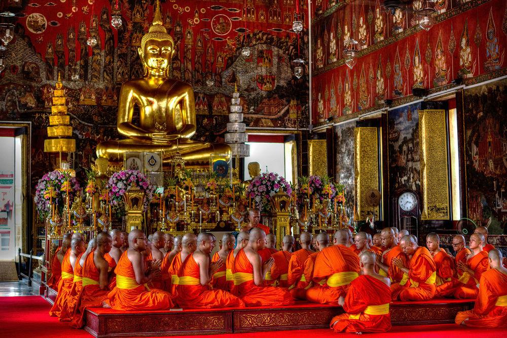 Monks pray in a temple by Zeno Bresson