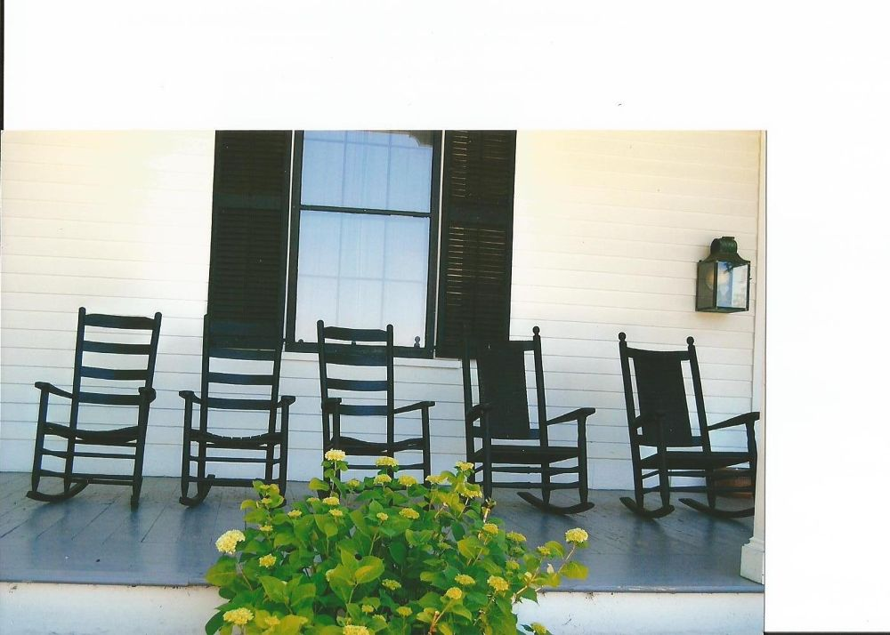 Chairs on porch by LynnSnow