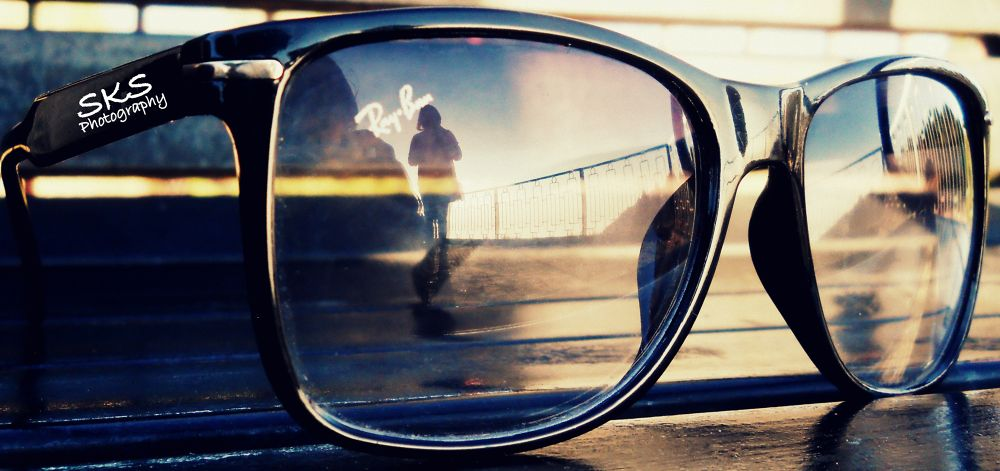 LOOKING THE WORLD THROUGH YOUR GLASSES. . . . by SHISHIR KUMAR SINGH