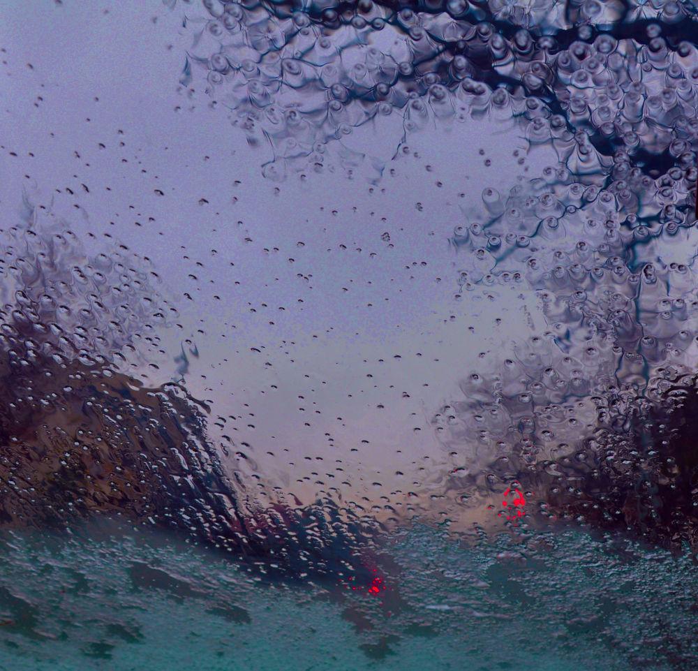Rain drops on the car window by  Nur Keyder