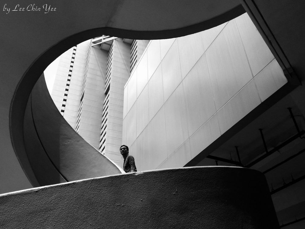 Man going up staircase by Chinyee