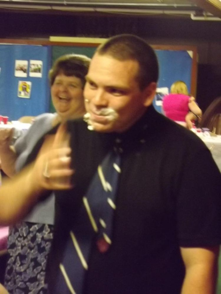 Josh with cake in face by kittenlove1959