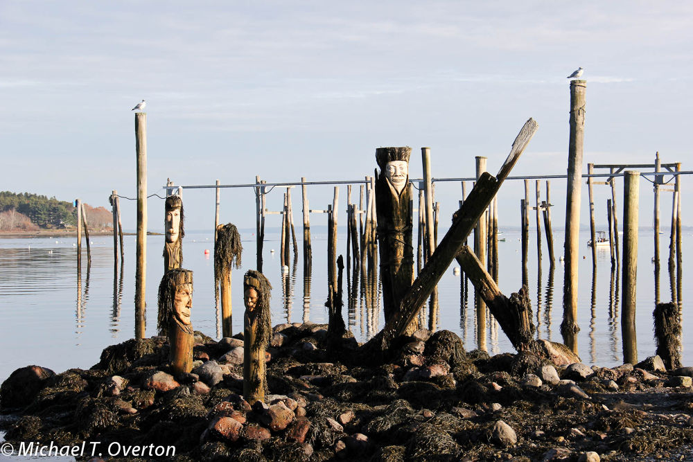 Totems in Belfast harbor. by Michael T. Overton