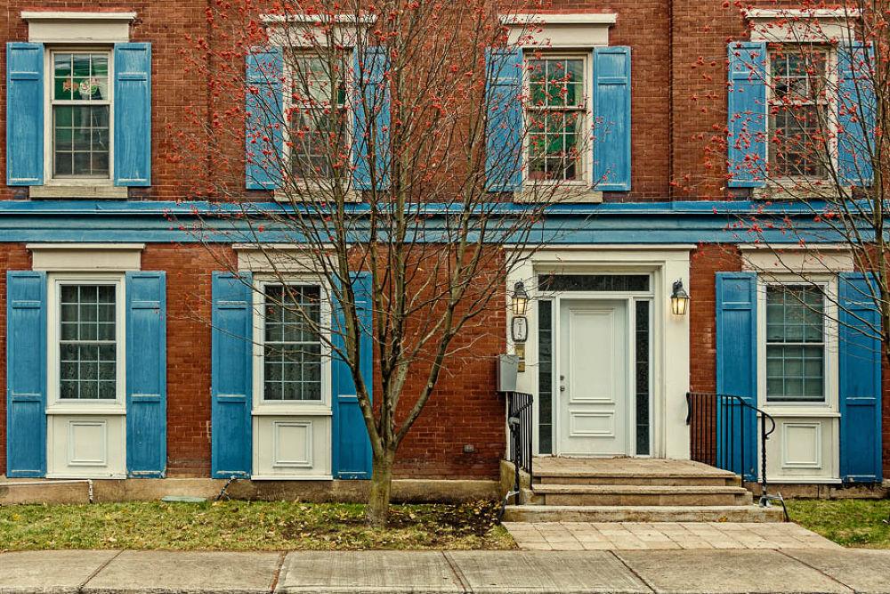 Photo in Urban #windows #door #blue #brick #red #facade #quebec #canadq #nikon #nikkor #d7000