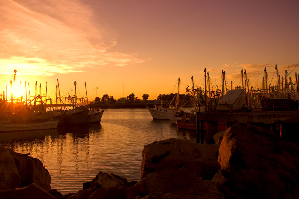 Sunset at the docks by Ginaellis