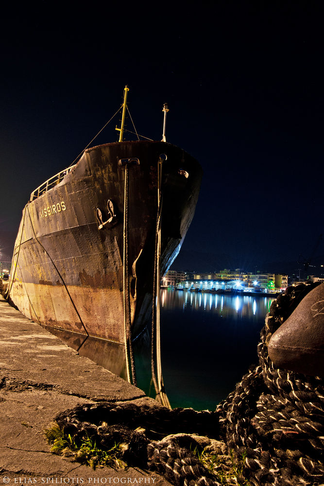At the harbour by Elias Spiliotis