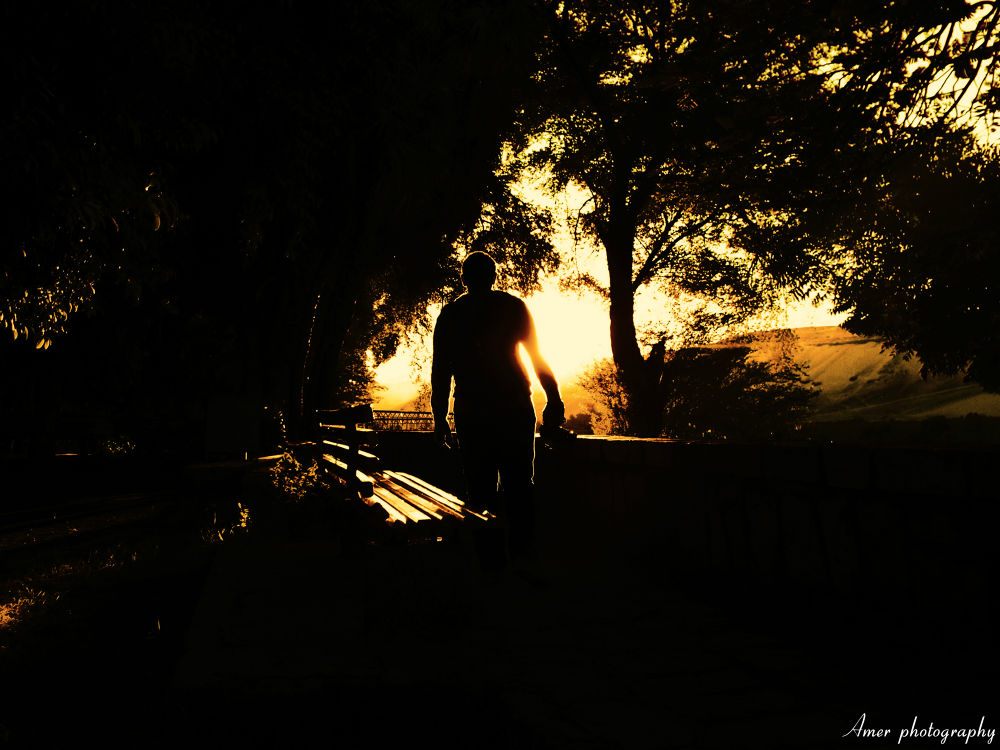 photographer in sunrise  by Muhammad amer
