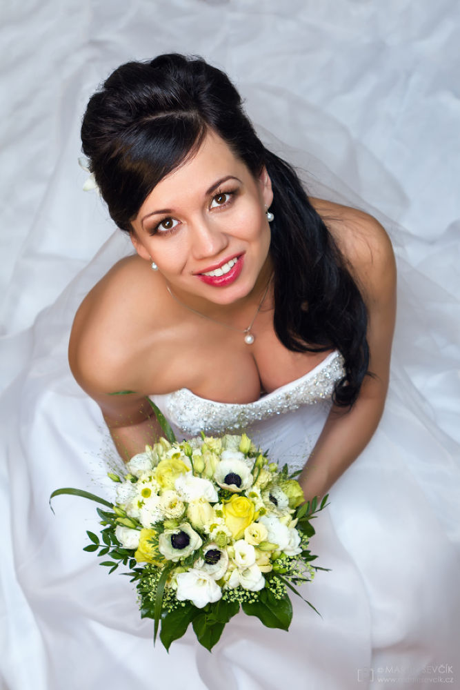 Beautiful bride with bouquet - wedding photo from above by Martin