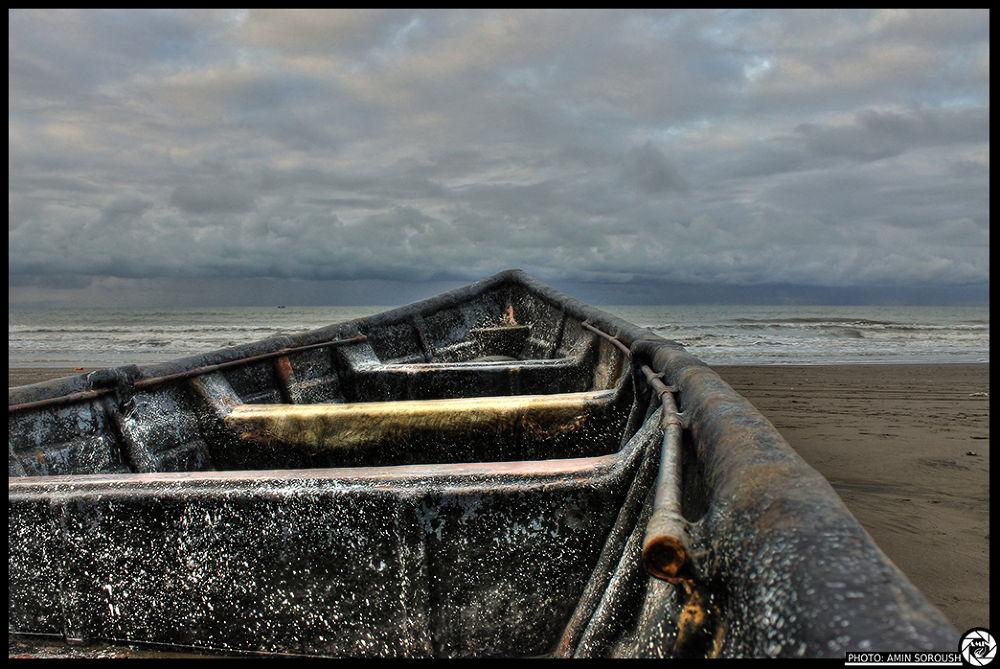 alone boat by Amin Soroush