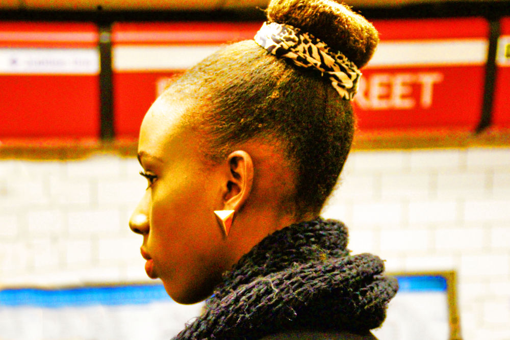 Waiting for her train on the London Underground by RusselWinterflood