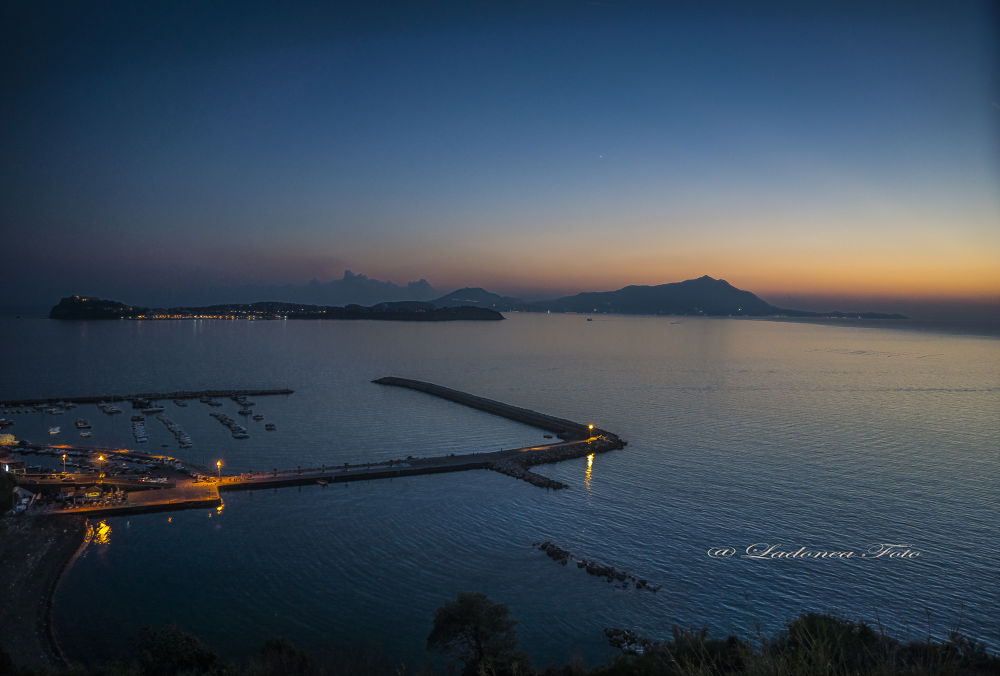 Sunset over island of Procida &Ischia..Napoli.Italy by parascandologiovanni