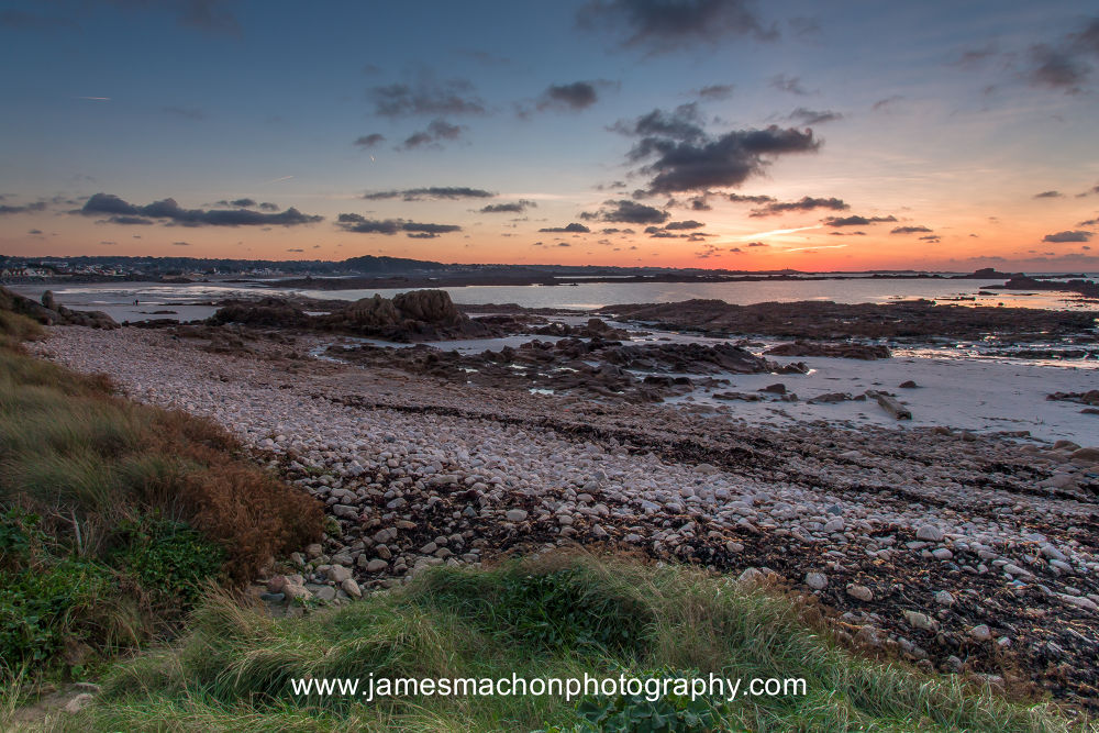 Sunset at Grandes Rocques Bay, Guernsey by James Machon Photography