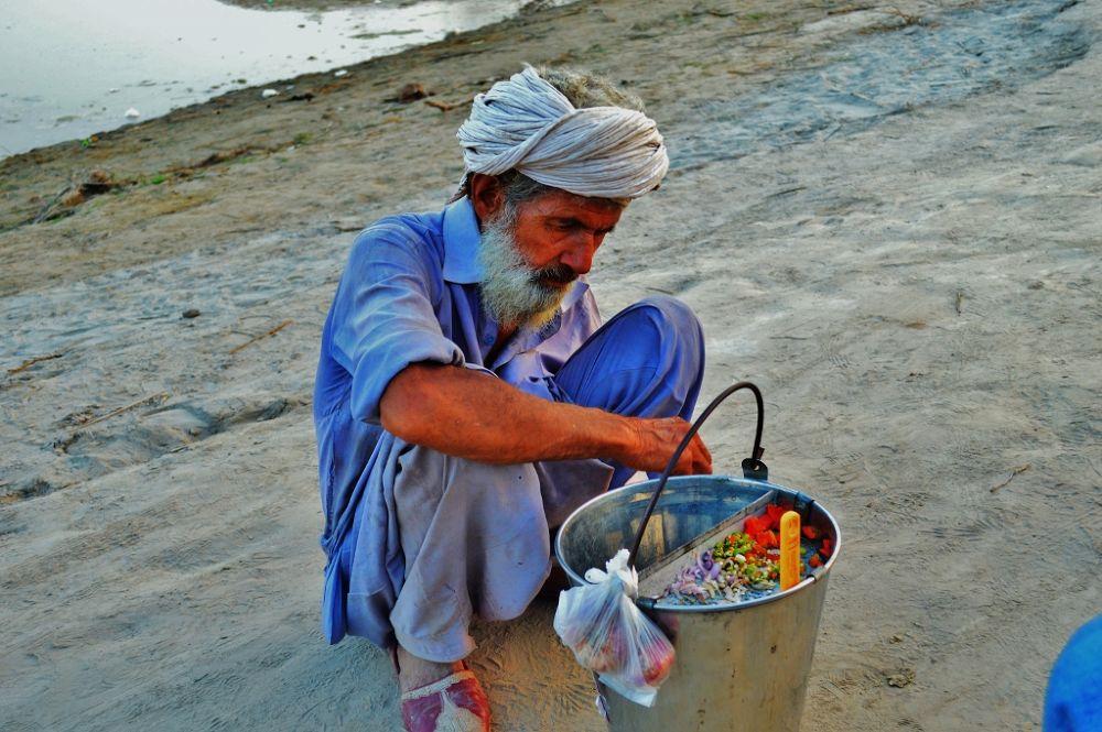 serving me with chicken peas... by Jawad Ghazanfar Naru