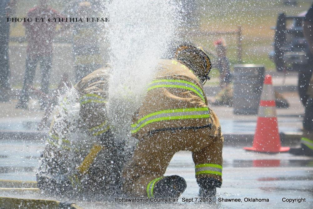 Pottawatomie County Fair Sept.2013 - Firefighter Games -  Fire Hose by dewmtnbug