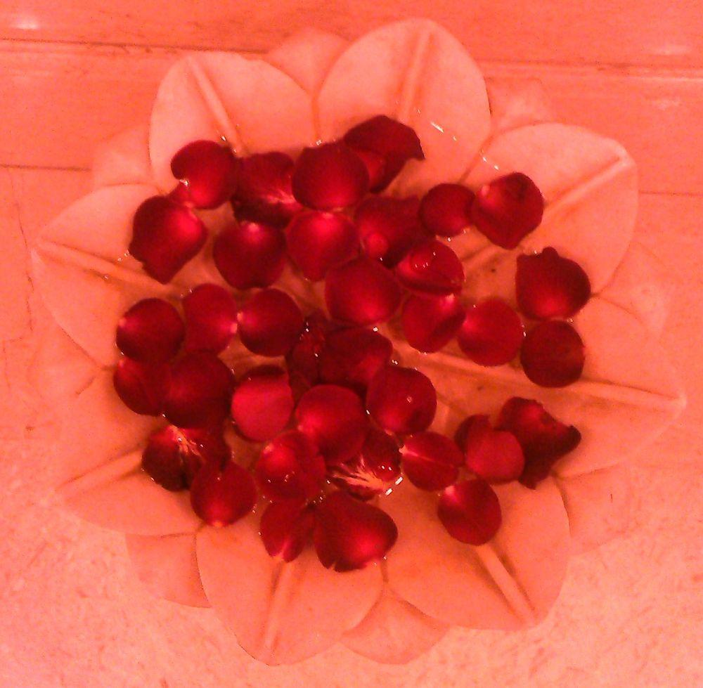 Rose Petals in Marble Water by RajeshwarPuvvada