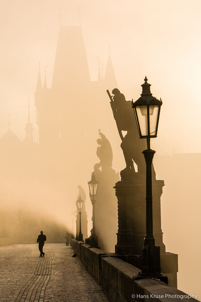 Karls Bridge in Prague in morning light by Hans Kruse