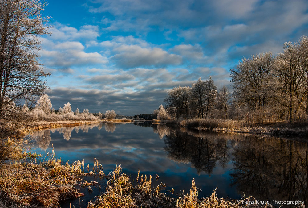 River in winter light by Hans Kruse