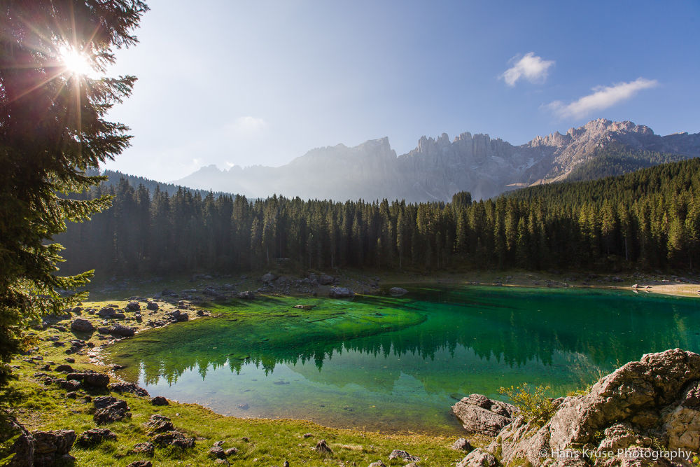 Lago di Carezza in morning sun by Hans Kruse