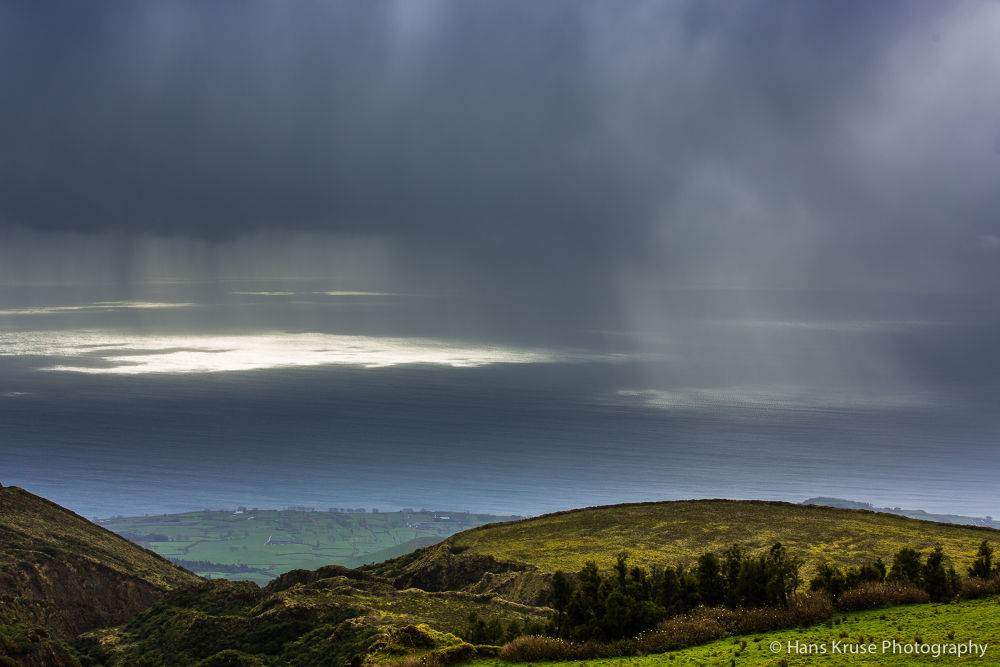Rain showers as seen from the north coast of Sao Miguel by Hans Kruse