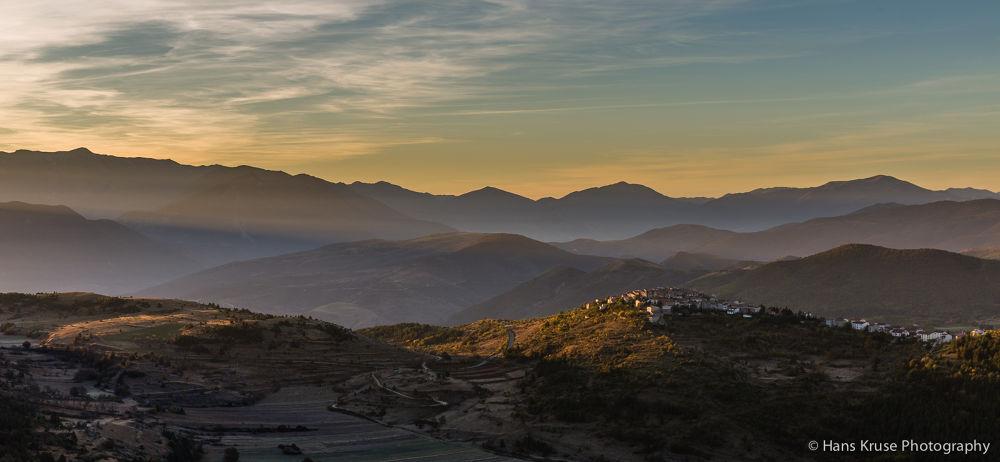 Morning sun hitting Castelvecchio Calvisio by Hans Kruse