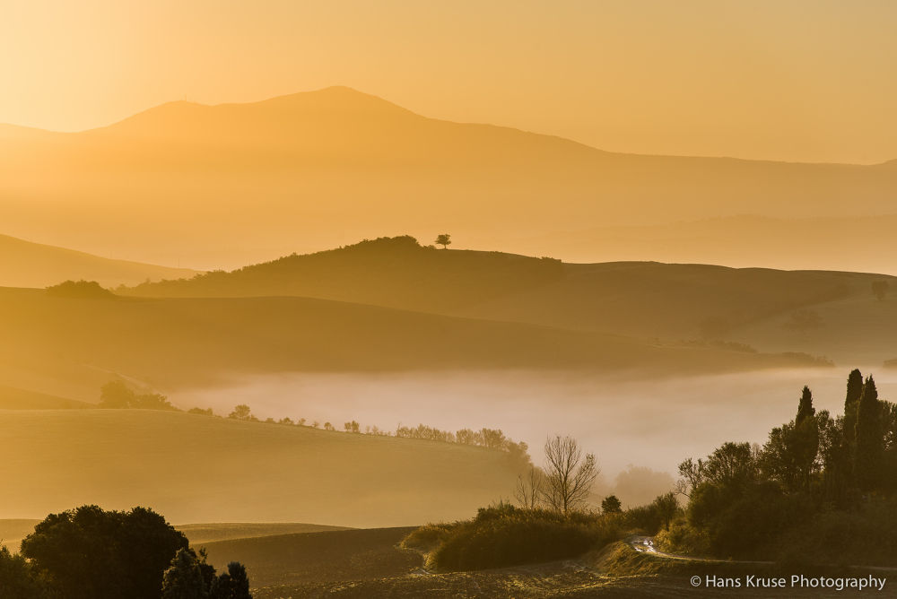 Tuscan landscape in morning light by Hans Kruse