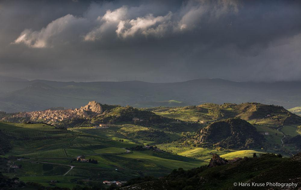 Sicilian landscape in dramatic light by Hans Kruse