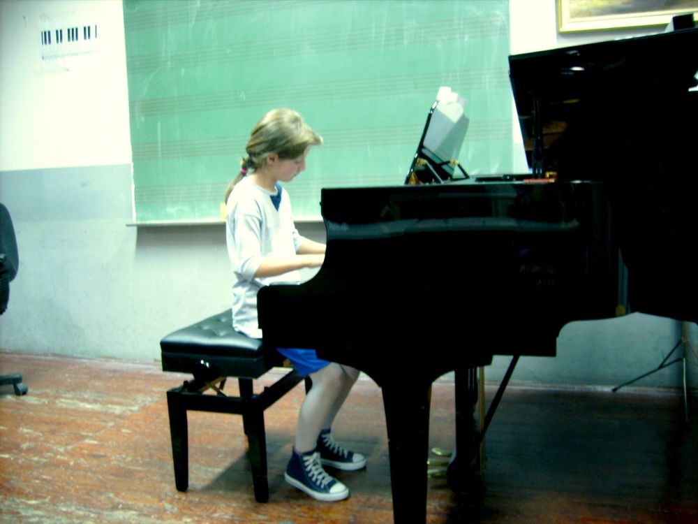 Piano girl by Ema