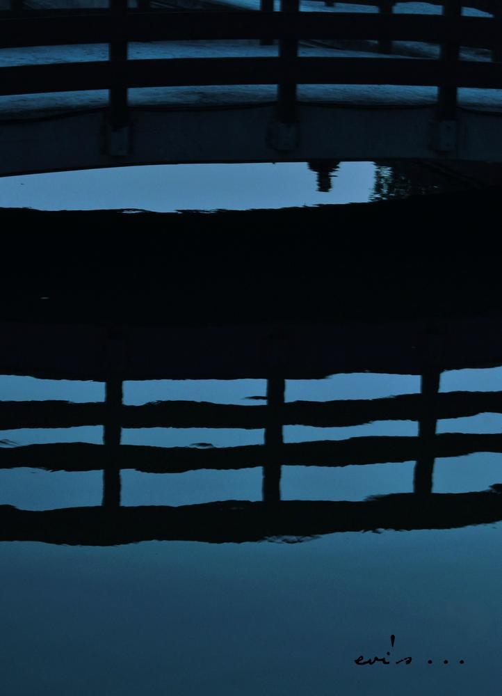 shadow on the bridge. by evipan1085