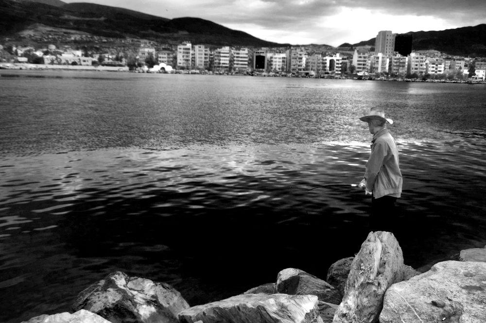 city fisherman by Aydın Tunçer Gonejko