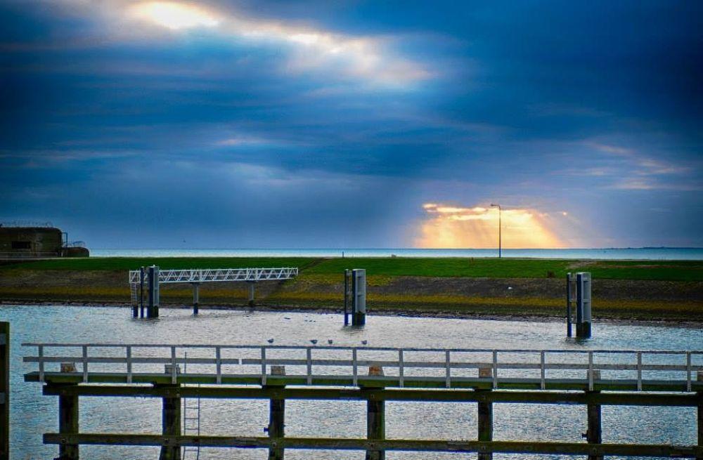 Sun above  IJsselmeer by janvanderlinden3557