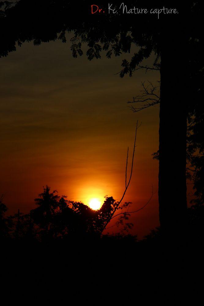 Sunset at another window by kalyanchakravarthi94064