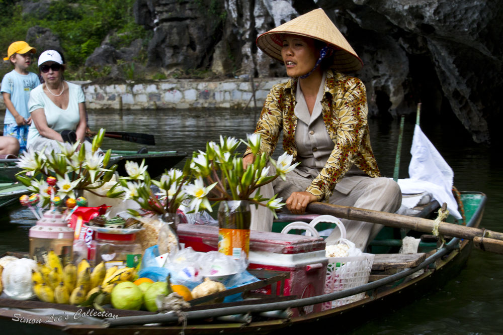 River traders at Tam Coc, Vietnam by simoncklee
