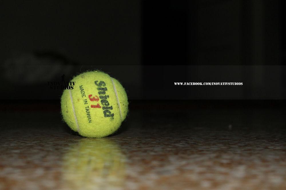 Tennis Ball by Usama Moin