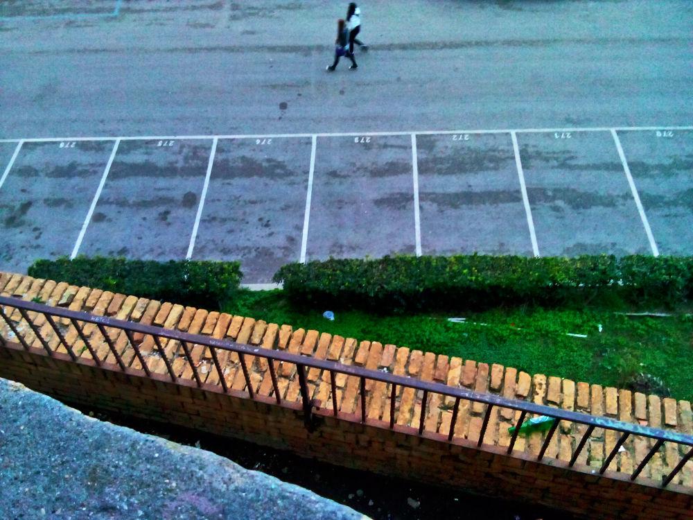 walking in the parking by Bernardo La Cara