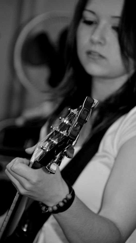 Guitar Playing by Angie Rumble