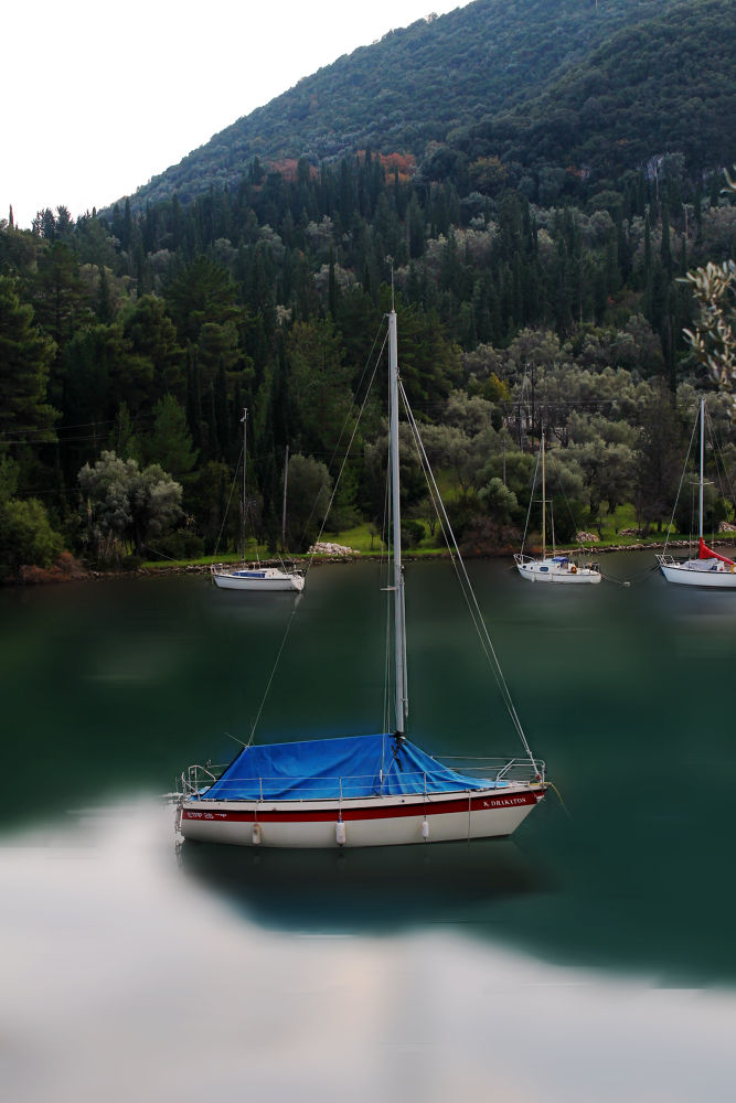 Photo in Landscape #boat #sea #reflection #red #blue #mountain #city #island #greece #forest #trees #sky