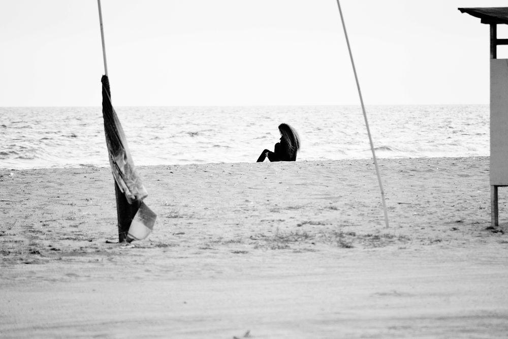 Thinking at the beach by lambriana