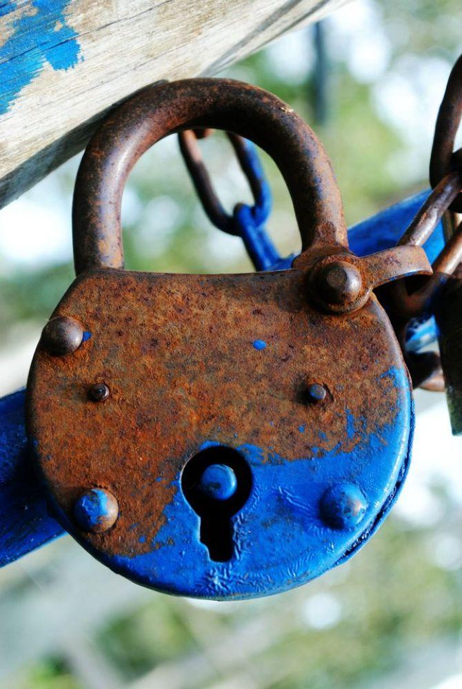 rusty padlocks by Daniel Paiva
