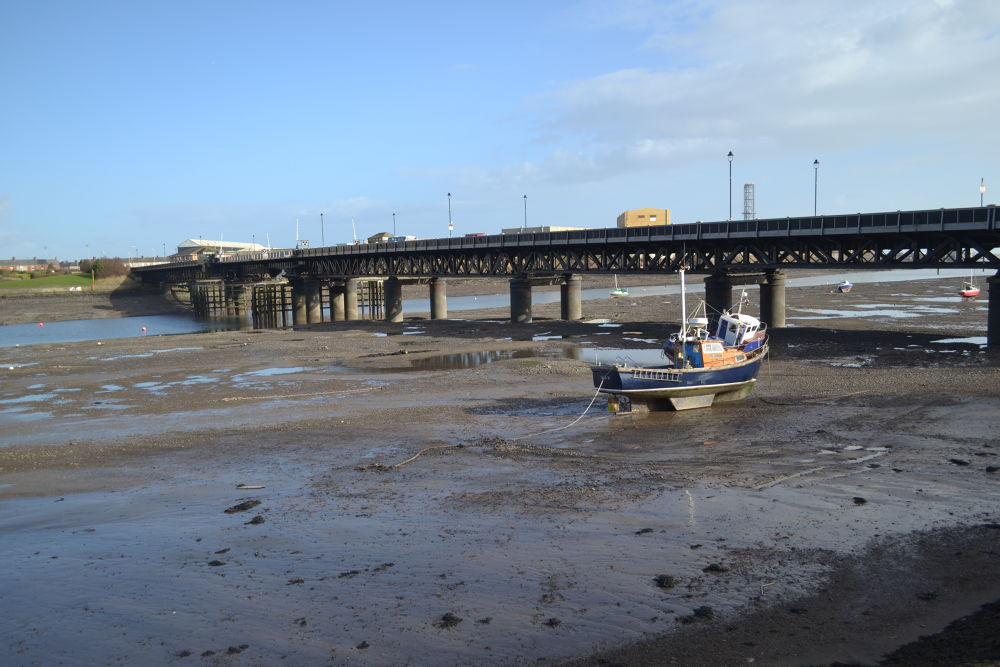 The Walney bridge at low tide. by Stephen Conway