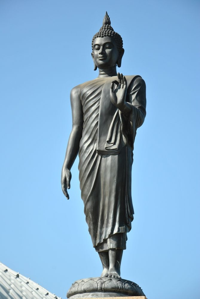 The Buddha in the posture of walking. by Wongphakdee