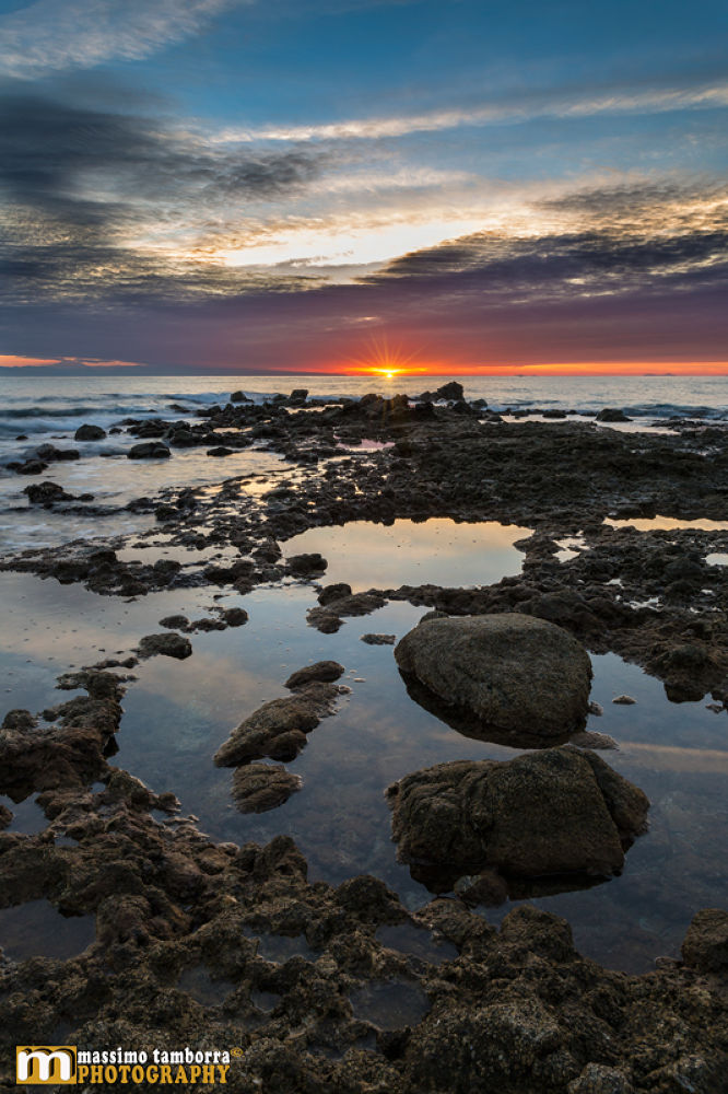 Low tide on the cliff - (Vertical) by Massimo Tamborra