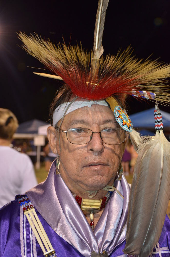 Cherokee Native wearing traditional dance regalia  by Bernice Thompson
