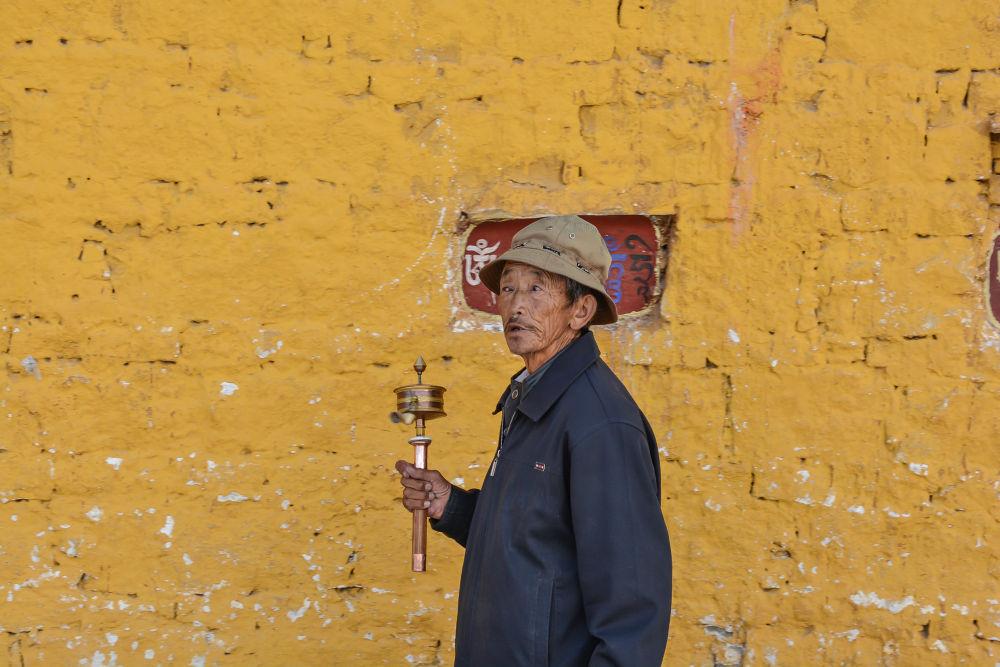 Photo in Journalism #buddhist #prayer #man #walking #temple #potala palace #lhasa #tibet #china #wheel