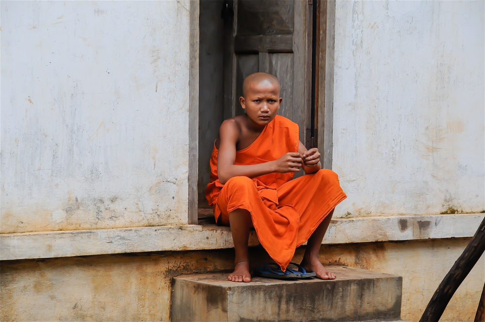 Young monk in training by cyourworldmyeyes