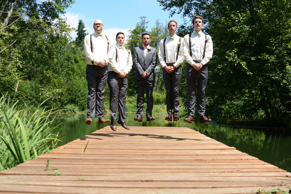Photo in Wedding #groom #groomsman #wedding #jump #pier #celebrate