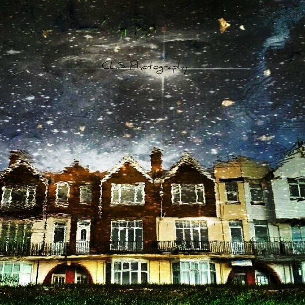 Photo in Cityscape #reflections #night #puddle #rain #houses #street