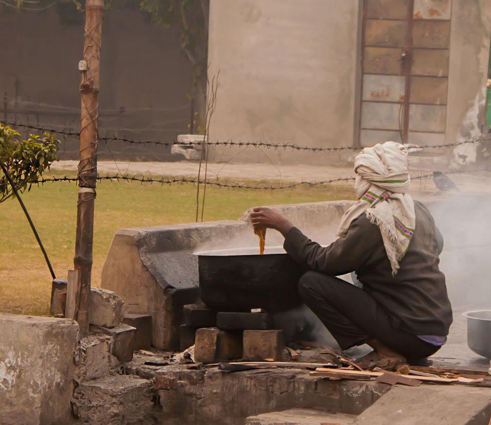 A Man washing Utensils by Subhan Shahid