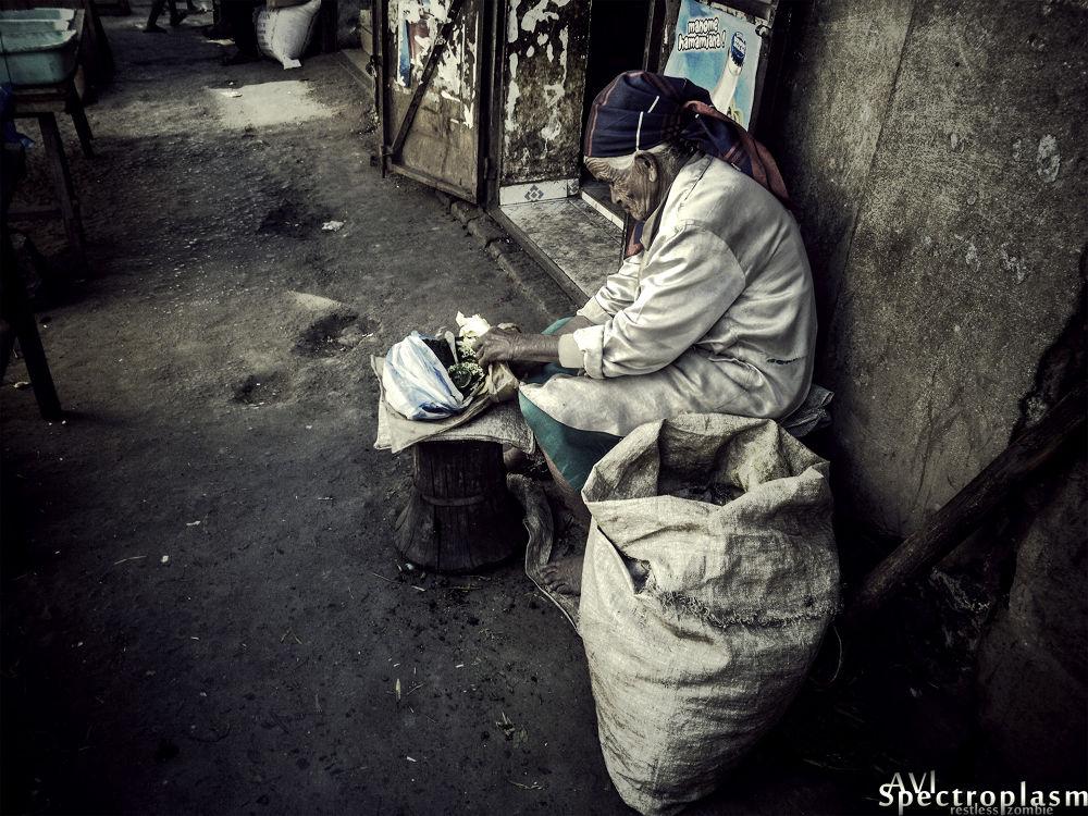 Photo in Street Photography #old woman #elder #kasava leaves #market #farmer #dragan #manual lens